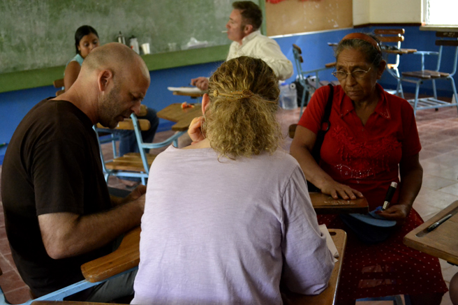 Sam Coffman working with a client in a community clinic.
