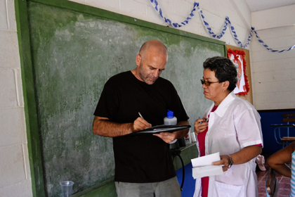Sam reviewing SOAP notes at a community clinic